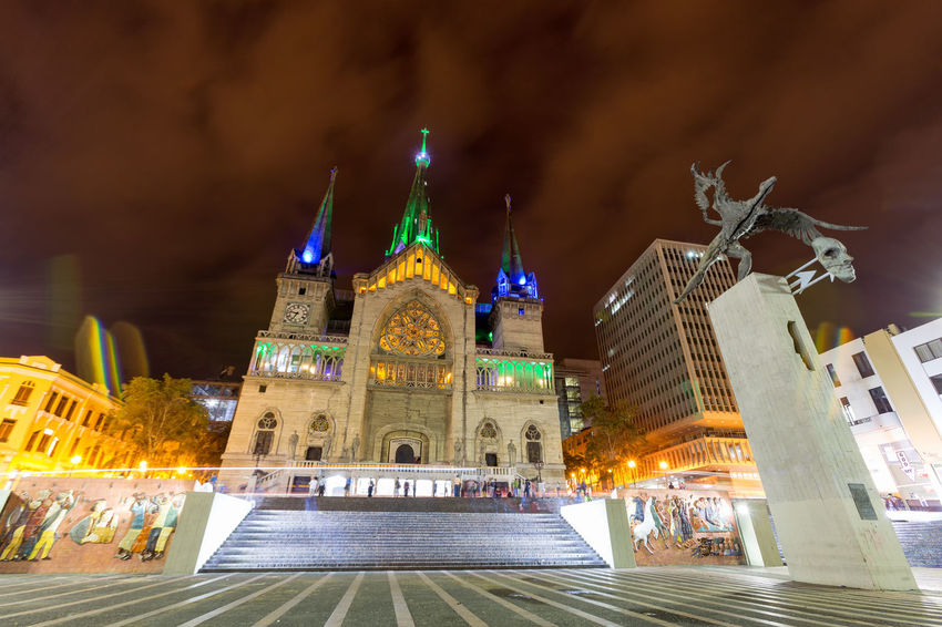 MANIZALES, COLOMBIA - JUNE 1: Central Bolivar Square with the neo-gothic Cathedral Basilica of Our Lady of the Rosary and Simon Bolivar statue at night on June 1, 2016 in Manizales, Colombia. Andes Architecture Bolivar City Cityscape Coffee Colombia Downtown Gothic Latin Manizales Nevado Simon Simón Bolívar South View America Andean Caldas Cathedral Basilica Of Our Lady Of The Rosary Coffee Triangle Colombian  Landscape Volcano Zone