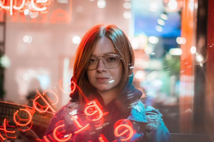 Portrait One Person Illuminated Front View Headshot Looking At Camera Real People Focus On Foreground Lifestyles Young Adult Night Leisure Activity Glowing Smiling Women Glasses Adult Eyeglasses  Hairstyle Light Neon Neon Lights Neon Sign Neon Photography