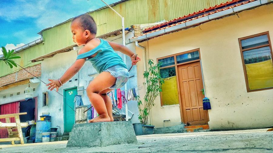 asian children Central Java INDONESIA Mobilephotography Full Length Childhood Playing Boys Males  Architecture Building Exterior Built Structure