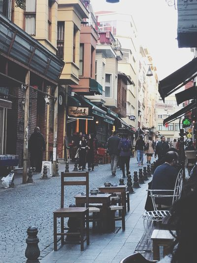 Turkishtea Architecture City Cafe Building Exterior Table Sidewalk Cafe Group Of People Built Structure Street Seat Chair Building Restaurant City Life Day City Street