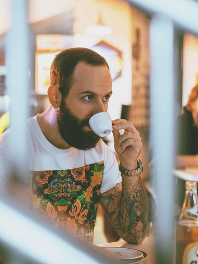 Arts Culture And Entertainment Beard Close-up Coffee Break Hipster Lifestyles Only Men Person Tattoo Vertical Young Adult