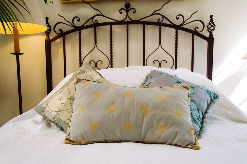 Close-up of pillows on bed