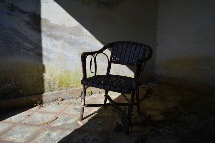 Loneliness. Loneliness Thinking Abandoned Absence Architecture Chair Damaged Day Deterioration Empty House Indoors  No People Old Seat Shadow Still Life Sunlight