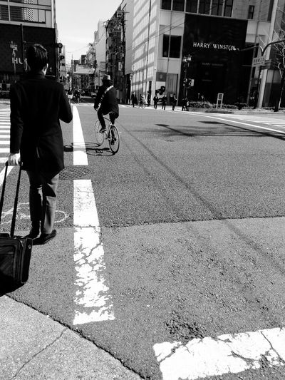 Black And White Photography Bwstreetphotography Osaka,Japan Harry Winston Bicycle Built Structure Building Exterior Architecture City Transportation Street Lifestyles City Life Person City Street Road Land Vehicle Casual Clothing Mode Of Transport Outdoors Day The Way Forward