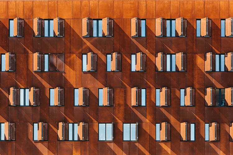 Detail of modern architecture building facade Cor-ten Apartment Architecture Arrangement Array Backgrounds Building Exterior Built Structure Day Design Full Frame In A Row Large Group Of Objects No People Outdoors Pattern Repetition Side By Side Steel Steel Structure  Sunlight Wall - Building Feature Window Windows Wood - Material The Architect - 2018 EyeEm Awards