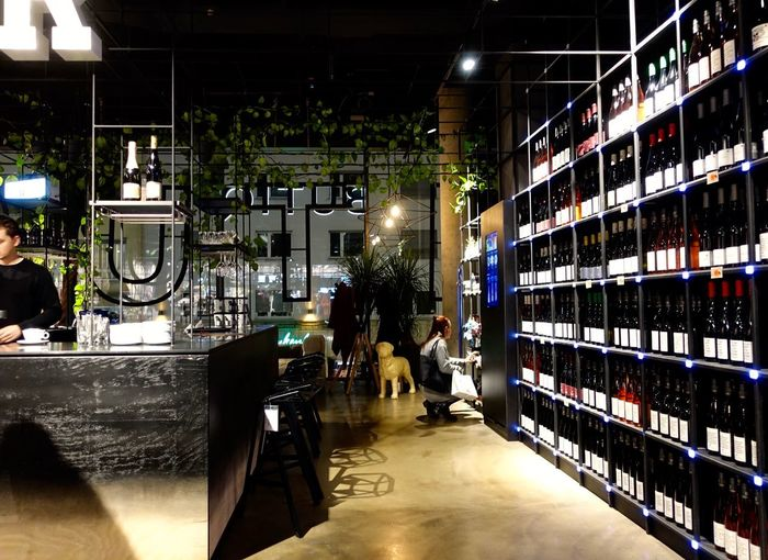 Weinregale; Verkauf 🎭💫👍 Bottle Indoors  Illuminated Refreshment Drink Alcohol My Best Photo Food And Drink Large Group Of Objects Incidental People Arrangement Wine Bottle Container Shopping Wine Cellar One Person Real People Shelf