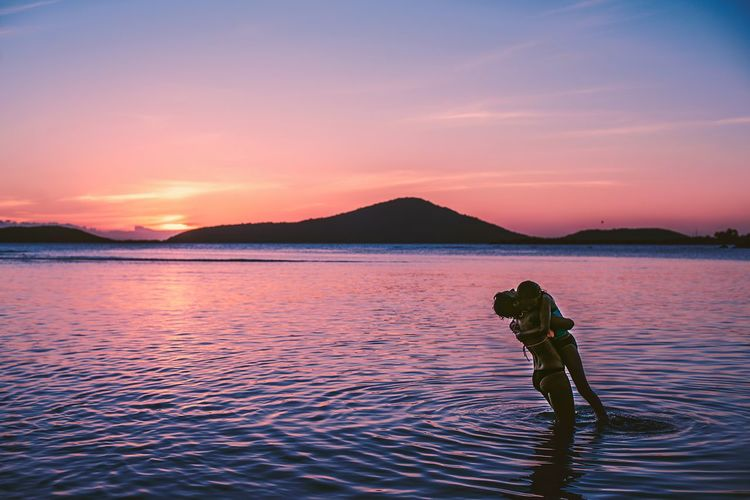 Water Sky Sunset Nature Full Length Real People Beauty In Nature Outdoors Scenics Lifestyles Standing Adventure Mountain Ankle Deep In Water Day People Mother & Daughter Mother Nature