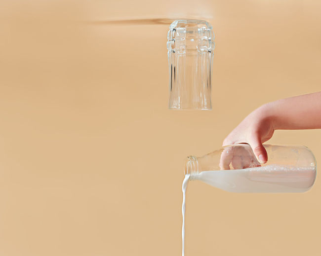 Close-up of person holding glass