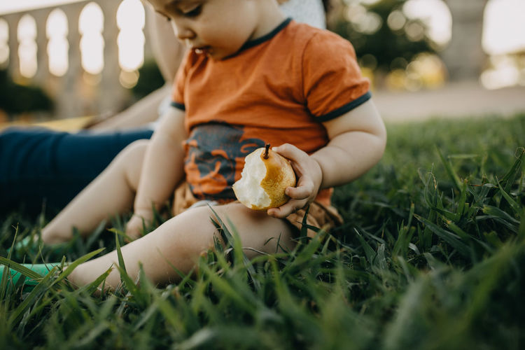 Boy playing with toy on grass