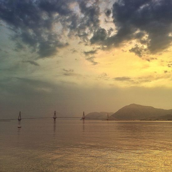 Syzeuxis Beauty In Nature Bridge Calm Cloud Cloud - Sky Cloudy Construction Engineering Idyllic Mountain Nature No People Non-urban Scene Outdoors Overcast Remote Rippled Scenics Sky Summer Sunset Tranquil Scene Showcase June Water