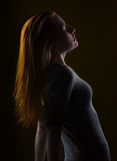 Adult Adults Only Beautiful People Beautiful Woman Beauty Black Background Close-up Indoors  One Person One Woman Only One Young Woman Only Only Women People Portrait Side View Silhouette Studio Shot Women Young Adult Young Women