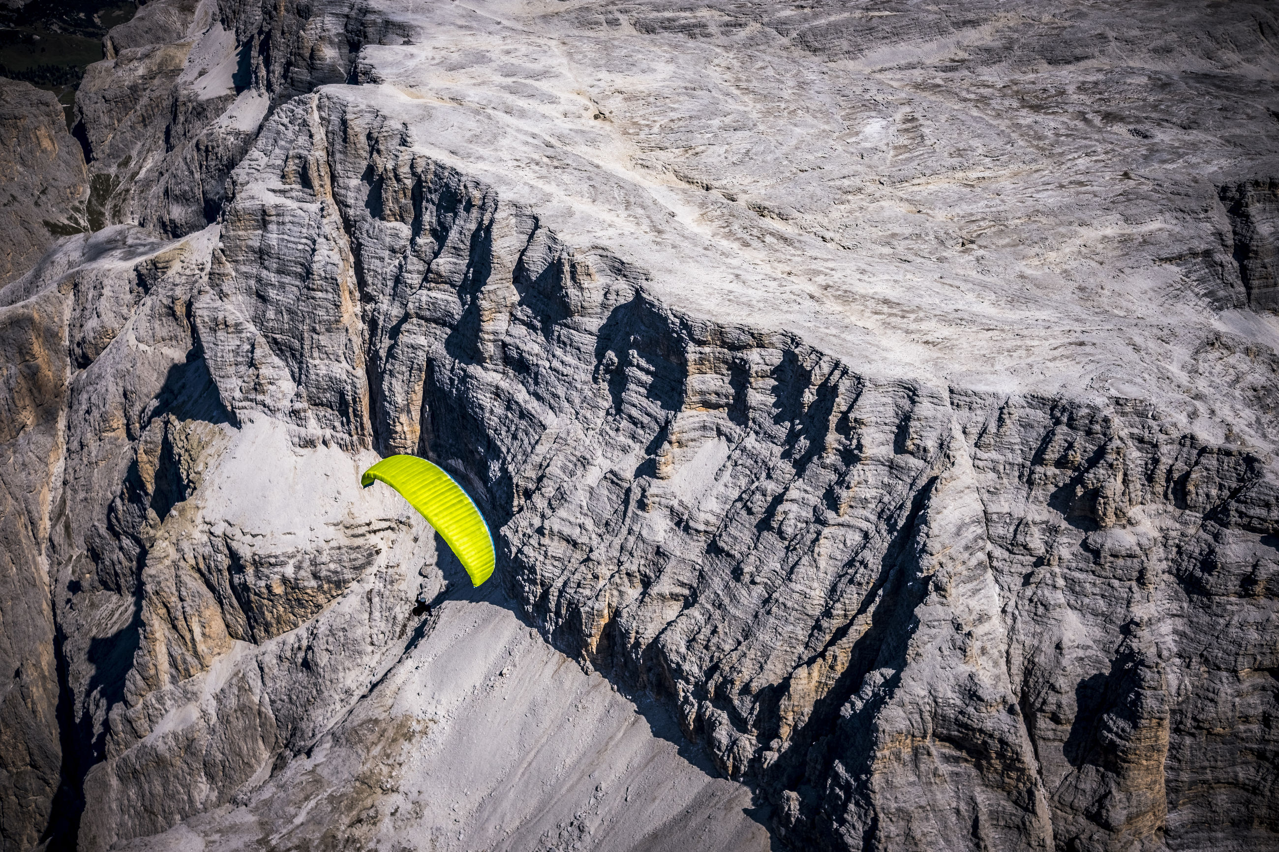 day, rock, nature, rock formation, solid, adventure, extreme sports, rock - object, outdoors, leisure activity, sport, beauty in nature, high angle view, yellow, people, animal wildlife, animals in the wild, land, formation