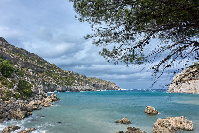 Anthony Quinn Bay on Rhodes Island while stormy weather Anthony Quinn Bay Rhodes Bay Beauty In Nature Day Greece Greece Islands Nature No People Outdoors Scenics Sea Sky Stormy Sky Tranquil Scene Tranquility Tree Water An Eye For Travel