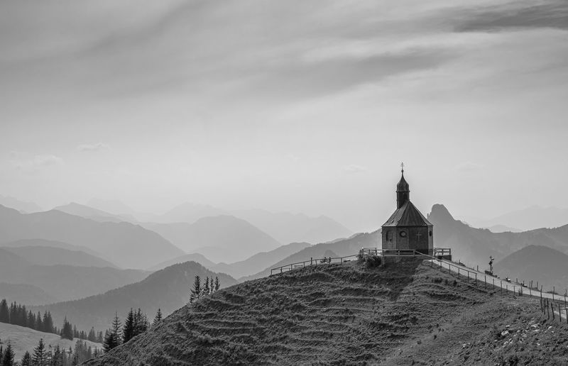 Church on mountain against sky