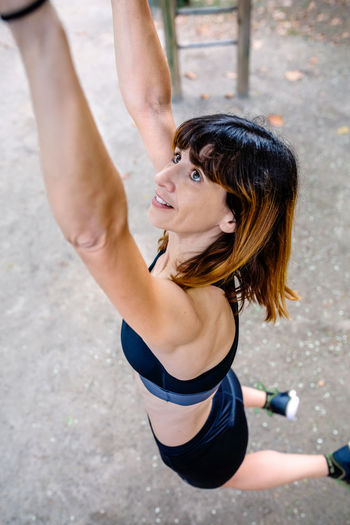 High angle view of woman with arms raised