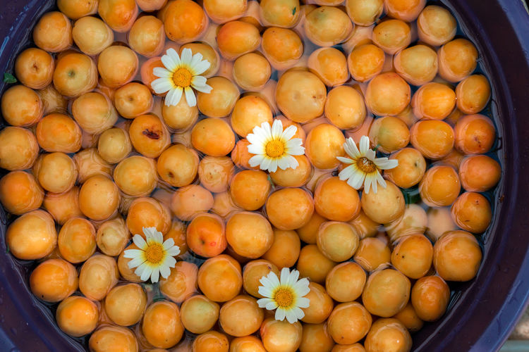 High angle view of oranges for sale at market stall