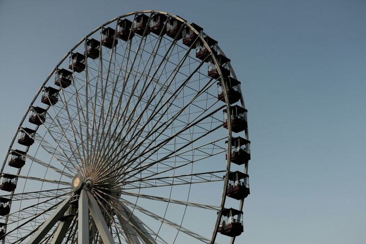 Low angle view of Ferris wheel against clear sky at Navy Pier