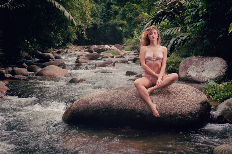 Adult Adults Only Beautiful Woman Beauty Blond Hair Day Fashion Model Full Length Nature One Person One Woman Only One Young Woman Only Only Women Outdoors People Portrait Real People River Rock - Object Sitting Stream - Flowing Water Water Women Young Adult Young Women