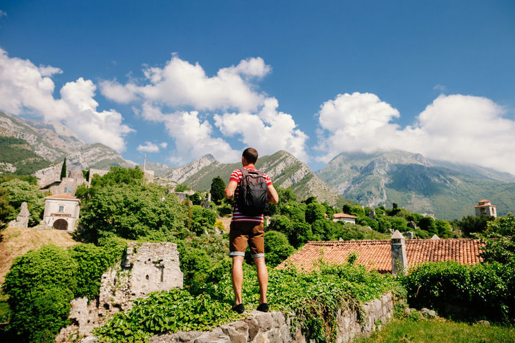 man travel Old Town on vacations in Montenegro. Freedom Hiking Montnegro Old Town Sky And Clouds Travel Traveling Travelling Vacations Backpack Beauty In Nature Beauty In Nature Casual Clothing Landscape Leisure Leisure Activity Male Mountain Nature Picturesque Real People Scenics Sky Summer Travel Destinations