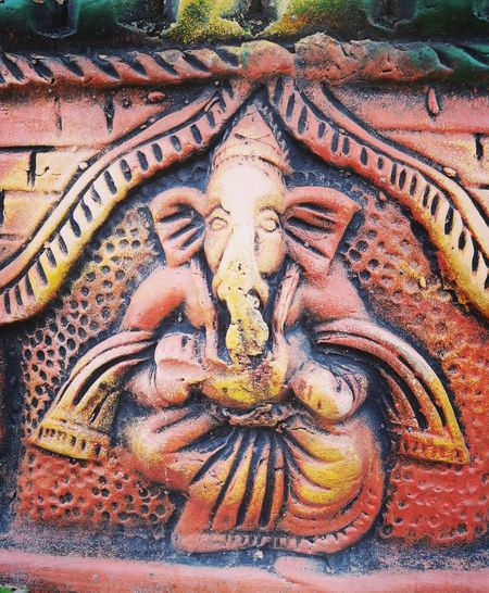 Ganesha Ganpati ArtWork Hindu Culture Clay Work TerracottaClose-up Art Is Everywhere Red Yellow Color Green Color Hindu Idol No People