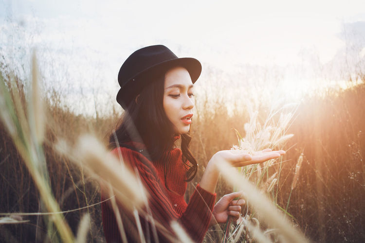 Young woman in hat on field