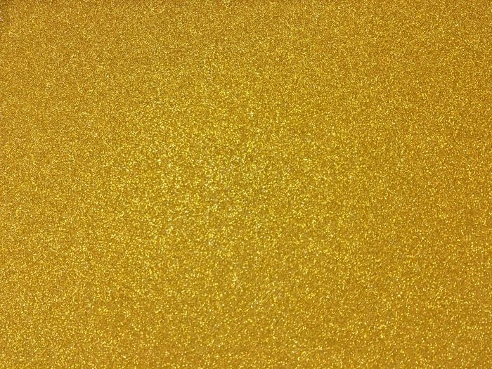 Full frame shot of golden glitter