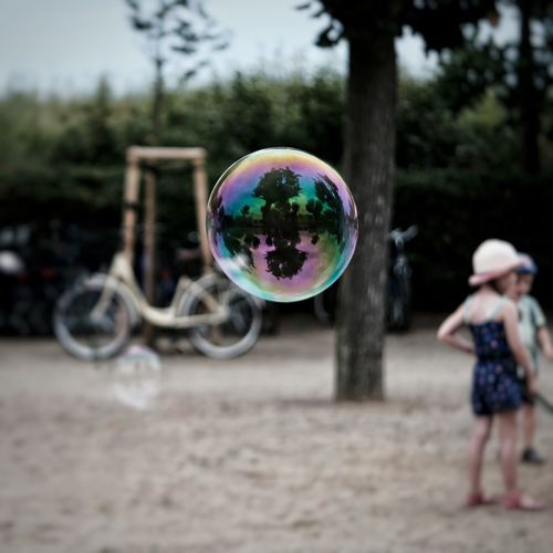 Bubble Bubble Reflection Real People Fragility Childhood Mid-air Focus On Foreground Tree Outdoors Day Leisure Activity Boys People