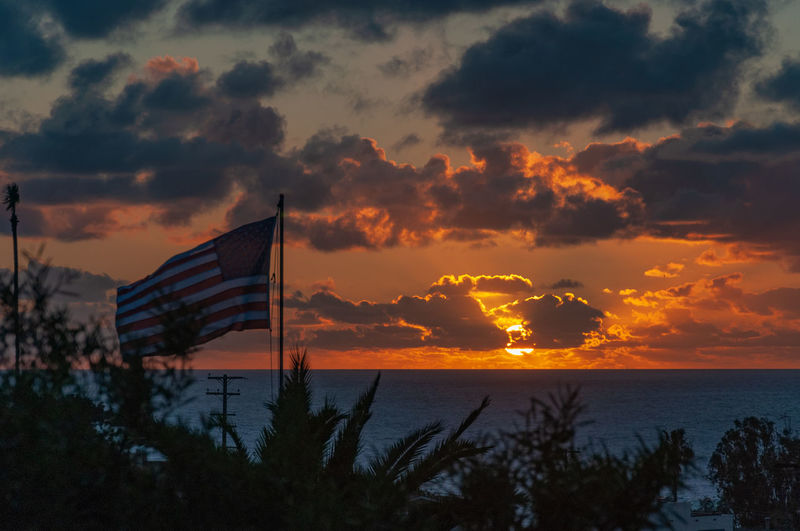 Flag at Ocean Sunset Sky Sunset Cloud - Sky Water Flag Sea Beauty In Nature Nature Scenics - Nature Orange Color Patriotism Tranquility No People Tranquil Scene Horizon Over Water Architecture Horizon Outdoors United States Ocean Beach San Diego