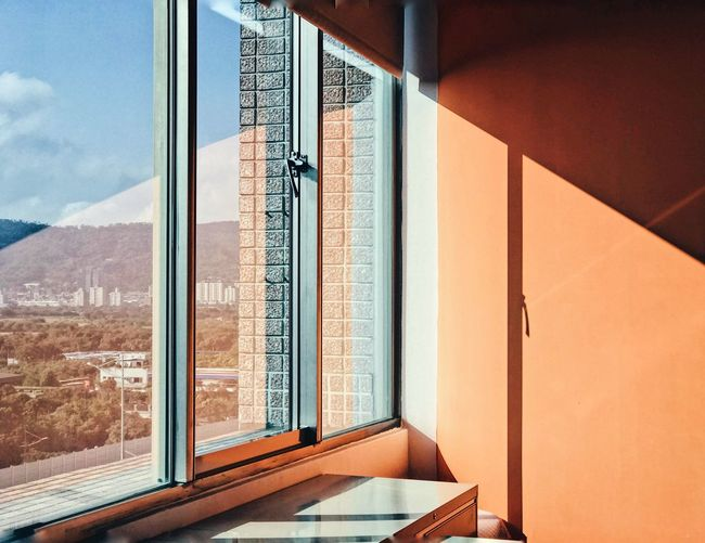 Office Window Interior Office Interior Orange Wall  Window EyeEm Selects Window Architecture Built Structure No People Day Glass - Material Transparent Sunlight Indoors  Reflection Open Nature Mountain Sky Architecture Reflection Modern Indoors