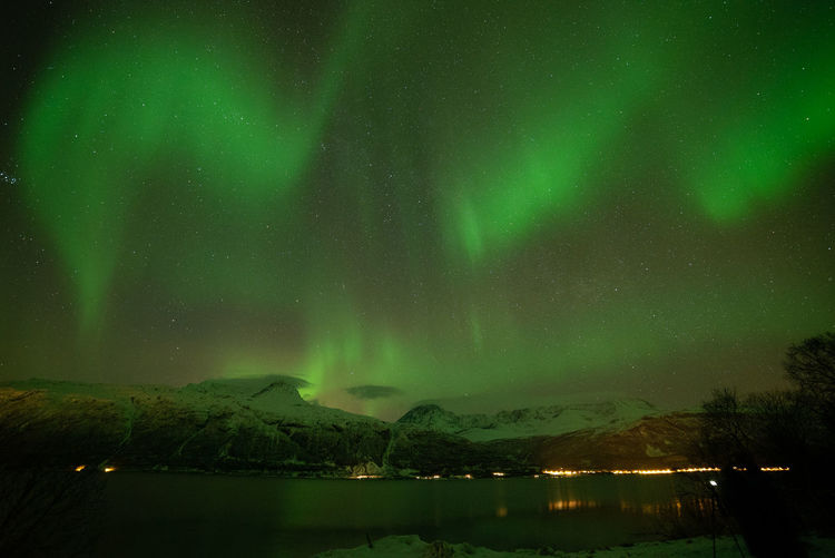 Aurora Borealis in Norway Geomagnetic Disturbance Kp-index Northern Lights Polar Lights Astronomy Aurora Polaris Beauty In Nature Geomagnetic Storm Green Color Idyllic Illuminated Lake Mountain Nature Night No People Non-urban Scene Scenics - Nature Sky Space Star - Space Tranquil Scene Tranquility Water Zulkefli