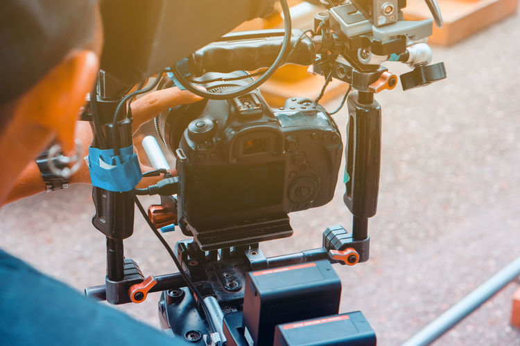 High angle view of man working on motorcycle