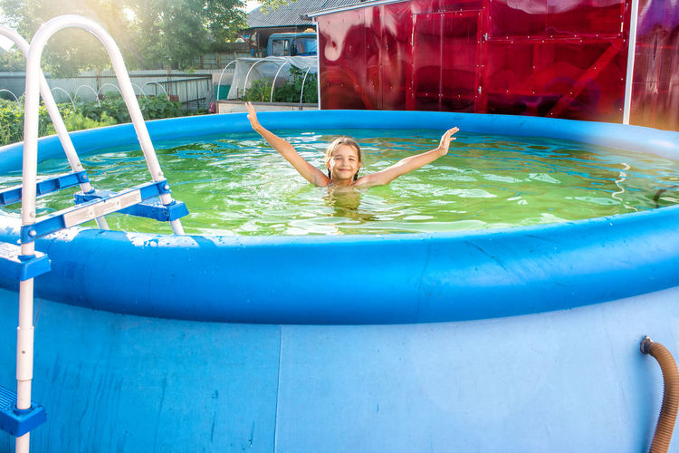 Girl Swimming In Wading Pool