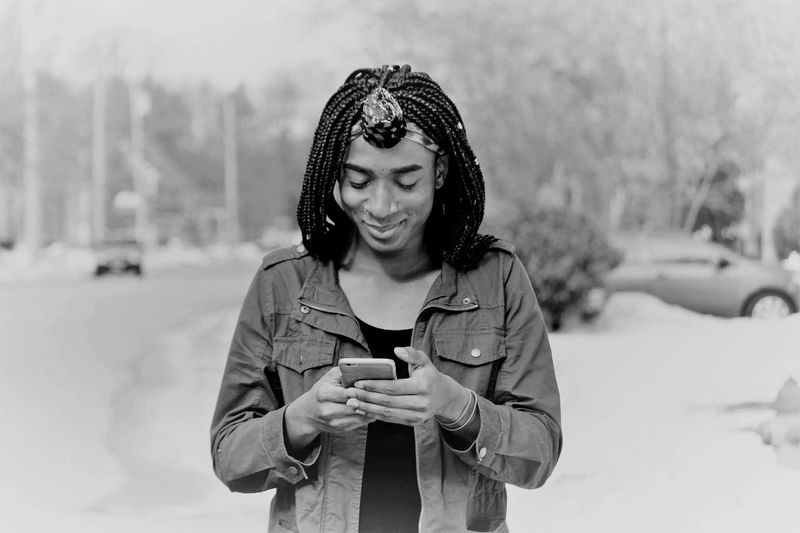 When he texts Off Guard Cell Phone  Cold Temperature Xoxo Black And White Texting EyeEm Selects Focus On Foreground Front View Winter One Person Outdoors Smiling Happiness Mobile Phone Technology