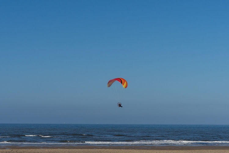 Paramotoring at the seaside. Marske beach. North east of England. Paramotor Paramotoring Paramoti-CE Plant Paragliding Parachute Paraglider Airborne Airborne All The Way Airborn Beach Marske Teesside Yorkshire England Europe European  Seaside Summer Season  Activity Sport Extreme Sports Fun Adventure Sky Beauty In Nature Sea Outdoors Horizon Over Water Water Horizon Unrecognizable Person Scenics - Nature Mid-air Land Day Leisure Activity One Person Freedom
