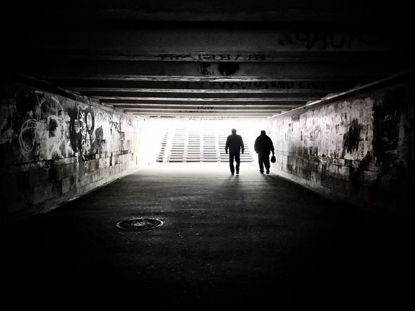 Real People Lifestyles Rear View The Way Forward Men Walking Tunnel Two People Full Length Built Structure Leisure Activity Indoors  Light At The End Of The Tunnel Day Architecture Women Togetherness Tunnel Vision Underground Passage Blackandwhite Kiev Ukraine Underground Shotoniphone7 Streetphotography Welcome To Black Welcome To Black Black And White Friday
