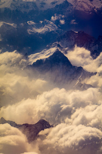 Low angle view of majestic mountains against sky