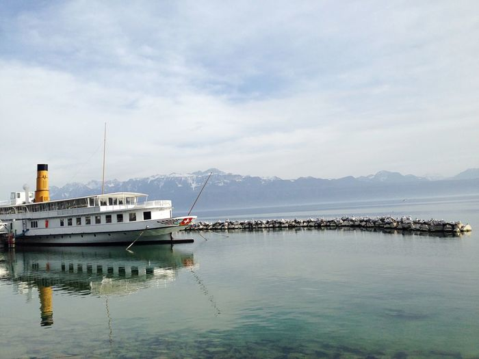 Water Cloud - Sky EyeEmNewHere EyeEm Best Shots Switzerland Lac Léman Lake View Lake Water Nautical Vessel Transportation Mode Of Transportation Sky Cloud - Sky Nature Travel Travel Destinations Harbor Ship No People Tourism Pier Mountain EyeEmNewHere The Great Outdoors - 2018 EyeEm Awards EyeEmNewHere