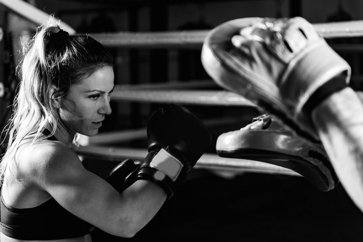 Woman on boxing training with personal trainer