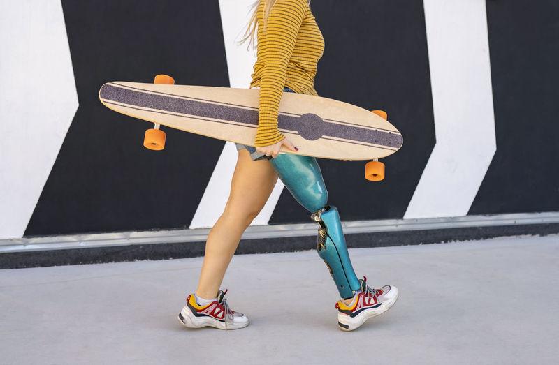 Low section of man skateboarding on skateboard