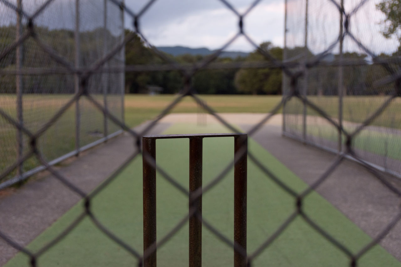 VIEW OF SOCCER FIELD SEEN THROUGH FENCE