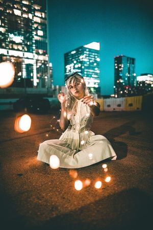 Illuminated Night City Architecture Built Structure Building Exterior One Person Real People Leisure Activity City Life Lifestyles Nightlife Outdoors Young Adult Full Length Young Women Sky People
