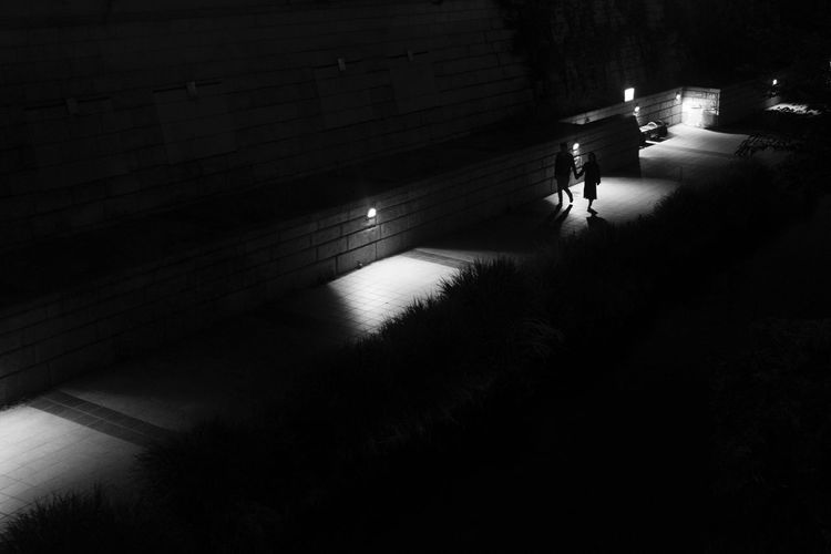 Couple Walking At Night