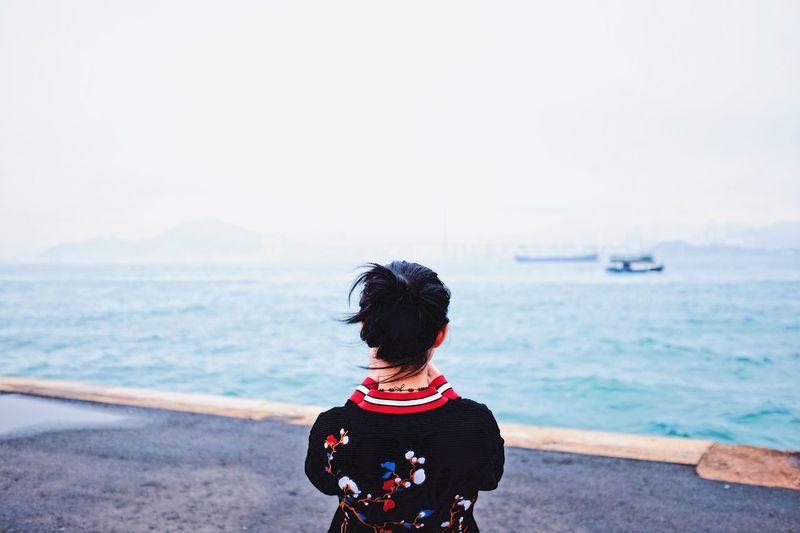 sea 🌊 Rear View Sea Leisure Activity Outdoors Sky Lifestyles Nature Beauty In Nature Streetphotography Urban HongKong Pier The Street Photographer - 2017 EyeEm Awards EyeEmNewHere
