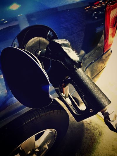 GOT GAS? Vehicle Gas Gas Pump Gas Station City City Life Night Dark Urban Everyday Lives Living Travel Traveling Refueling Blue Gasoline Expenses Transportation Land Vehicle Mode Of Transport Pedal Car Road No People Tire Close-up