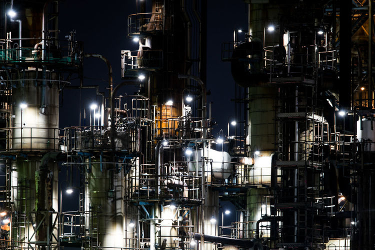 Low angle view of illuminated factory at night