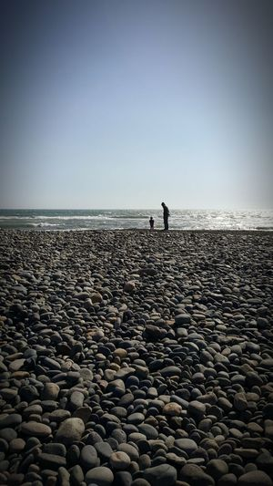 Sea Beach Horizon Over Water Pebble Sky Water Silhouette Outdoors People Nature Clear Sky Beauty In Nature Pebble Beach