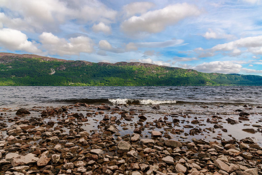Scotland UrquhartCastle Beach Beauty In Nature Cloud - Sky Day Highlands Of Scotland Loch Ness Mountain Nature No People Outdoors Pebble Beach Scenics Sea Sky Tranquil Scene Tranquility Water