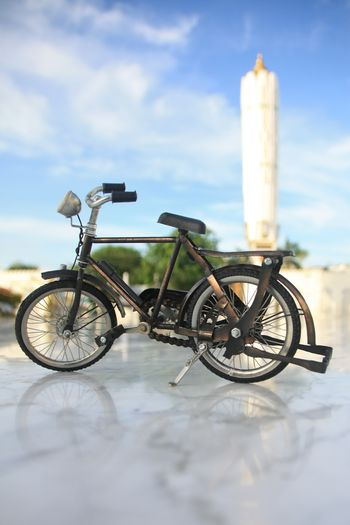 Bicycle Transportation Land Vehicle Cloud - Sky Mode Of Transportation Day No People Nature Sky Outdoors Selective Focus Stationary Focus On Foreground White Color Land Close-up Travel Wheel Sea Surface Level Architecture Aceh