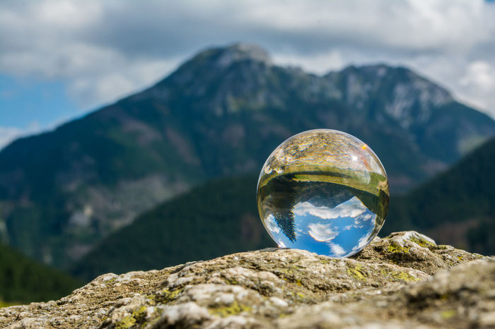 Beauty In Nature Close-up Cloud - Sky Crystal Crystal Ball Day Focus On Foreground Green Color Landscape Mountain Mountain Range Nature No People Outdoors Physical Geography Reflection Rock - Object Scenics Sky Sphere Tranquility Tree EyeEm Best Shots EyeEm Nature Lover Been There. The Creative - 2018 EyeEm Awards