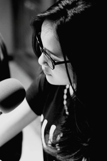 High angle view of female radio jockey in studio